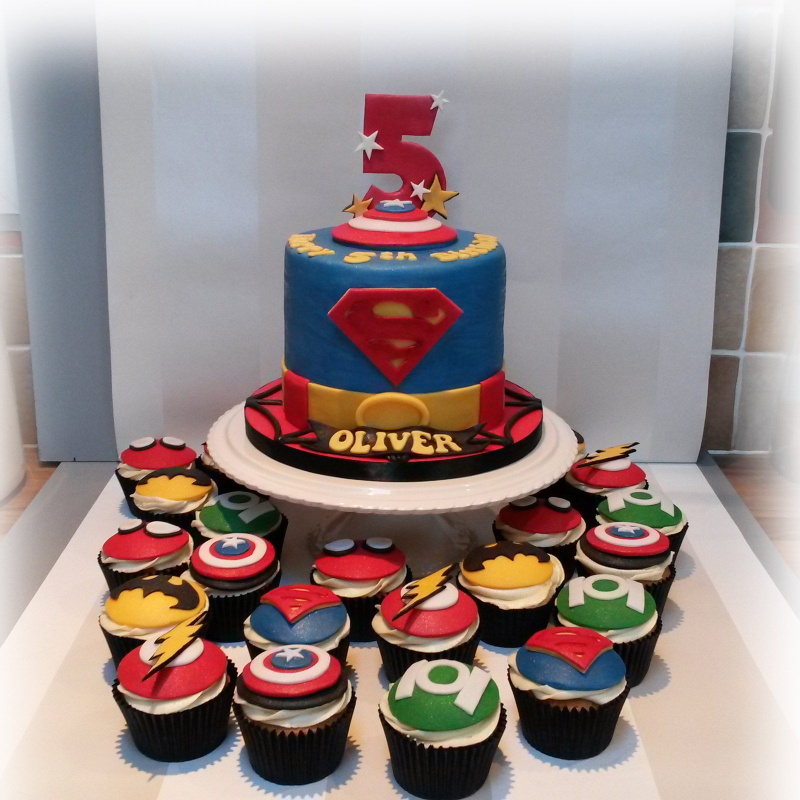 Superhero Cake And Cupcakes Bakealous