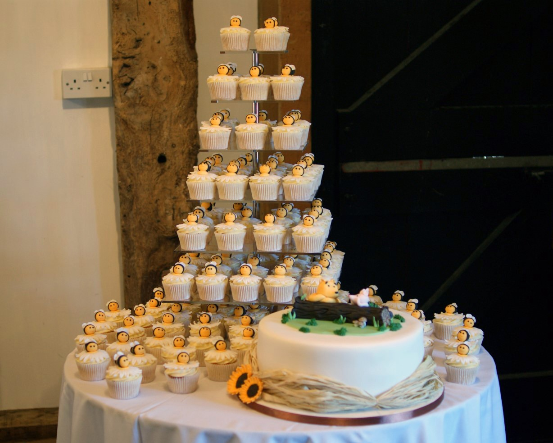Winnie The Pooh Wedding Cake With Cupcakes