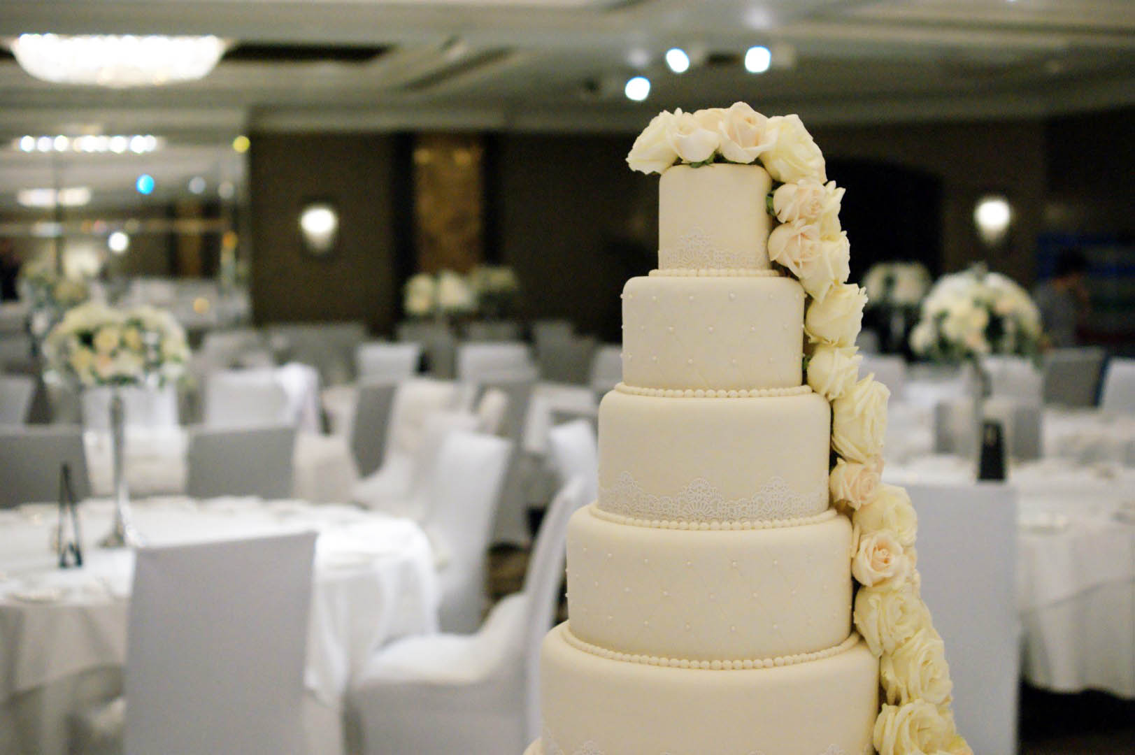 6 Tier Ivory Wedding Cake, Fresh Roses - Bakealous