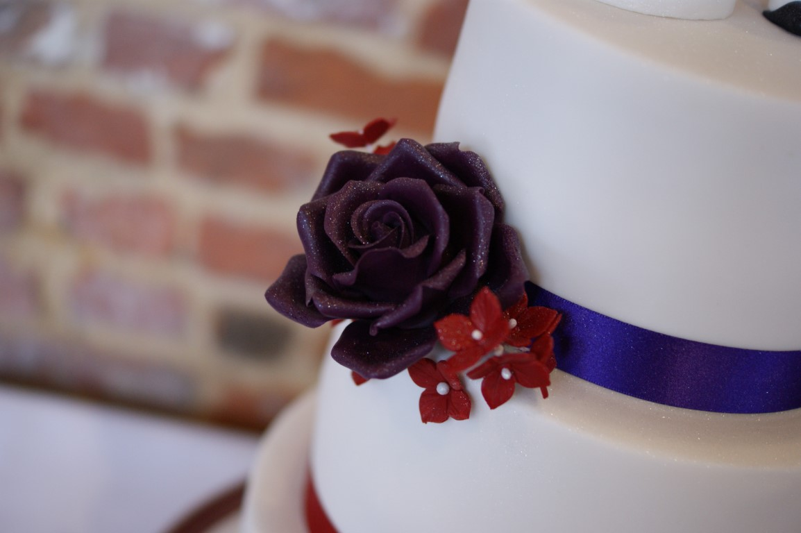 3 Tier Wedding Cake With Character Toppers 10 Bakealous