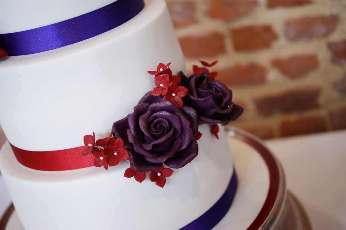 3 Tier Wedding Cake With Character Toppers 11 Bakealous