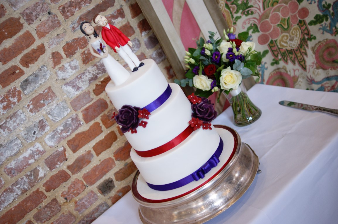 3 Tier Wedding Cake With Character Toppers 14 Bakealous