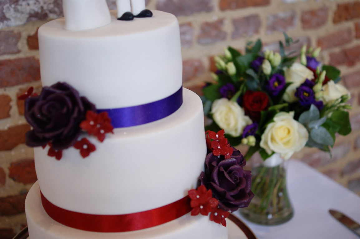 3 Tier Wedding Cake With Character Toppers 19 Bakealous