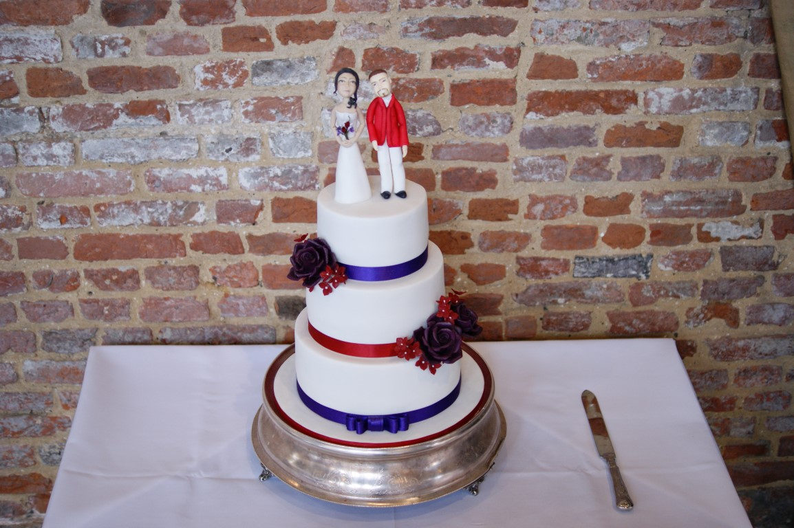 3 Tier Wedding Cake With Character Toppers 9 Bakealous