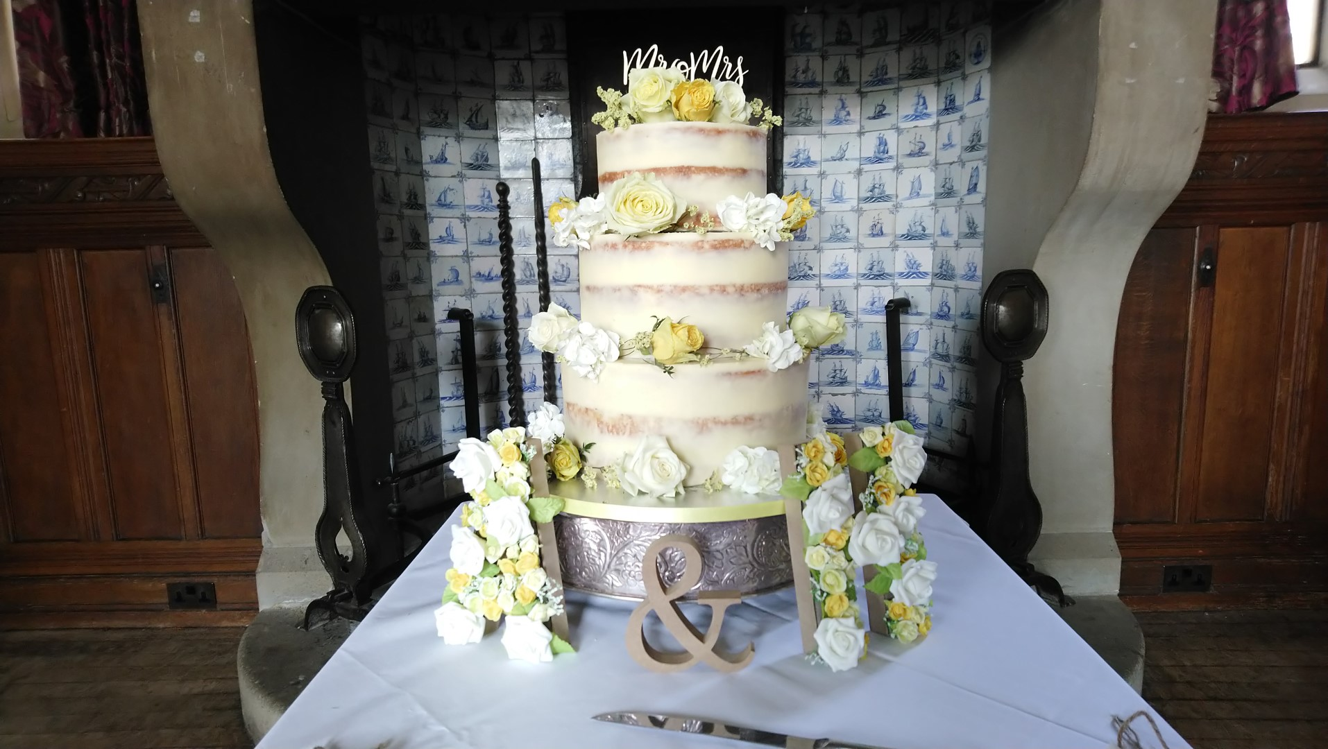Semi Naked 3 Tier Wedding Cake With Yellow White Fresh Flowers